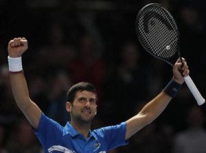 ASSOCIATED PRESS                                 Serbia's Novak Djokovic celebrates after defeating Italy's Matteo Berrettini in their ATP World Tour Finals singles tennis match at the O2 Arena in London today.
