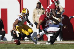 ASSOCIATED PRESS                                 Alabama quarterback Tua Tagovailoa fumbles in front of LSU safety JaCoby Stevens in the first half.