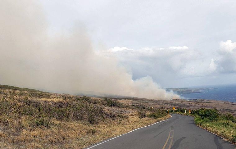 COURTESY MAUI MAYOR'S OFFICE                                 Smoke billowed from a brush fire in the Kahikinui are on Maui Thursday afternoon.