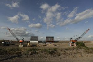 ASSOCIATED PRESS / NOV. 7                                 The first panels of levee border wall are seen at a construction site along the U.S.-Mexico border in Donna, Texas. Three years into Donald Trump's presidency, the U.S. government is finally ramping up its efforts to seize the private land it needs to build a border wall in South Texas.