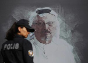 ASSOCIATED PRESS                                 A Turkish police officer walked past a picture of slain Saudi journalist Jamal Khashoggi, Oct. 2, prior to a ceremony, near the Saudi Arabia consulate in Istanbul, marking the one-year anniversary of his death. A court in Saudi Arabia has sentenced five people to death for the killing of Washington Post columnist Jamal Khashoggi, who was murdered in the Saudi Consulate in Istanbul in October 2018 by a team of Saudi agents.