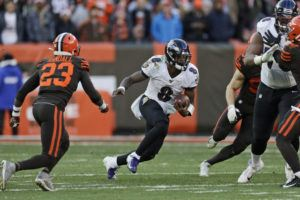 ASSOCIATED PRESS                                 Baltimore Ravens quarterback Lamar Jackson scrambled against the Cleveland Browns during the second half, Sunday, in Cleveland. The Ravens won 31-15.