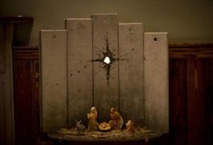 "ASSOCIATED PRESS                                 A new artwork dubbed ""Scar of Bethlehem"" by the artist Banksy is displayed in The Walled Off Hotel, in the West Bank city of Bethlehem, Sunday."