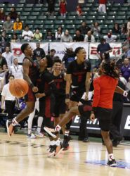 ASSOCIATED PRESS / MARCO GARCIA                                 Houston players celebrated after defeating No. 21 Washington in the Diamond Head Classic championship game today at the Stan Sheriff Center.