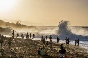 DENNIS ODA / DODA@STARADVERTISER.COM                                 People watch the high surf at Waimea Bay on Tuesday.