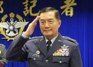 ASSOCIATED PRESS                                 Taiwanese top military official Shen Yi-ming salutes as he is introduced to journalists during a press conference in Taipei, Taiwan, on March 7.