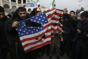 "ASSOCIATED PRESS                                 Protesters burned a U.S. flag during a demonstration over the U.S. airstrike in Iraq that killed Iranian Revolutionary Guard Gen. Qassem Soleimani, in Tehran, Iran, Friday. Iran has vowed ""harsh retaliation"" for the U.S. airstrike near Baghdad's airport that killed Tehran's top general and the architect of its interventions across the Middle East, as tensions soared in the wake of the targeted killing."
