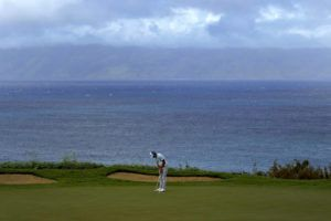 ASSOCIATED PRESS Rickie Fowler putts on the 12th green during third round of the Tournament of Champions on Saturday at the Kapalua Plantation Course.