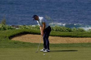 ASSOCIATED PRESS                                 Justin Thomas putts on the 12th green during third round of the Tournament of Champions golf event, Saturday, at Kapalua Plantation Course.