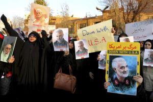 ASSOCIATED PRESS                                 Protesters chant slogans and hold up posters of Gen. Qassem Soleimani during a demonstration in front of the British Embassy in Tehran, Iran, today.