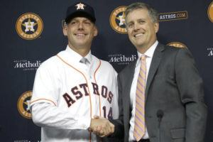 ASSOCIATED PRESS                                 Houston Astros general manager Jeff Luhnow, right, and A.J. Hinch posed after Hinch was introduced, in Sept. 2014, as the new manager of the baseball club in Houston. Hinch and Luhnow were fired today after being suspended for their roles in the team's extensive sign-stealing scheme from 2017.
