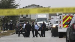 ASSOCIATED PRESS                                 Law enforcement officers secure an area at the scene of a shooting in San Antonio, Texas, on Monday. Three people surrendered peacefully after a more than five-hour standoff that followed the fatal shooting of a man by officers outside a house where the three then refused to come out, police said.