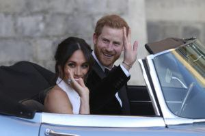 ASSOCIATED PRESS                                 Meghan Markle and Prince Harry leave Windsor Castle in a convertible car after their wedding in Windsor, England, in 2018.