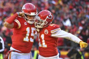 ASSOCIATED PRESS                                 The Kansas City Chiefs' Patrick Mahomes celebrates with Demarcus Robinson after running for a touchdown during the first half.