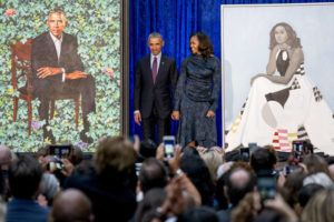 ASSOCIATED PRESS / Feb. 12                                 Former President Barack Obama and former first lady Michelle Obama stand on stage together as their official portraits are unveiled at a ceremony at the Smithsonian's National Portrait Gallery in Washington. The portraits will begin a five-city national tour in Chicago in June 2021.