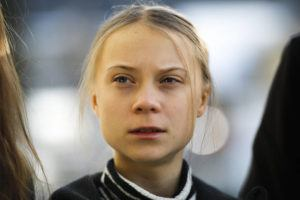 ASSOCIATED PRESS                                 Swedish climate activist Greta Thunberg posed for media as she arrived for a news conference in Davos, Switzerland, today.