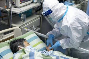 XINHUA VIA AP                                 In a photo released by China's Xinhua News Agency, a medical worker attends to a patient in the intensive care unit at Zhongnan Hospital of Wuhan University in Wuhan in central China's Hubei Province on Friday.