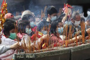 ASSOCIATED PRESS                                 People burn joss sticks as they pray at the Wong Tai Sin Temple, in Hong Kong, to celebrate the Lunar New Year which marks the Year of the Rat in the Chinese zodiac.