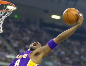 ASSOCIATED PRESS / 2001                                 Kobe Bryant reaches back for a rebound during the first half of game four of the Western Conference semifinals against the Sacramento Kings in Sacramento, Calif., on May 13, 2001.