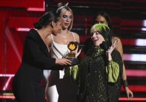 INVISION / AP                                 Alicia Keys, from left, and Dua Lipa present Billie Eilish with the award for best new artist at the 62nd annual Grammy Awards.
