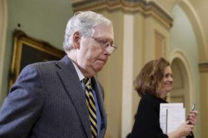 ASSOCIATED PRESS                                 Senate Majority Leader Mitch McConnell of Ky., departed the chamber on Capitol Hill in Washington, Monday, after the impeachment trial of President Donald Trump on charges of abuse of power and obstruction of Congress ended for the day.