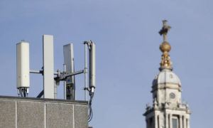 """ASSOCIATED PRESS                                 Mobile network phone masts are visible in front of St Paul's Cathedral in the City of London, today. The Chinese tech firm Huawei has been designated a """"high-risk vendor"""" but will be given the opportunity to build non-core elements of Britain's 5G network, the government has announced. The company will be banned from the """"core"""", of the 5G network, and from operating at sensitive sites such as nuclear and military facilities, and its share of the market will be capped at 35%."""
