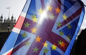 ASSOCIATED PRESS                                 An anti-Brexit campaigner waved European Union and Union flags outside Parliament in London, Wednesday. Britain officially leaves the European Union on Friday after a debilitating political period that has bitterly divided the nation since the 2016 Brexit referendum.