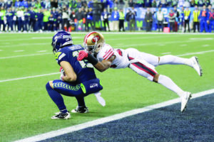 ASSOCIATED PRESS                                 Seattle Seahawks' John Ursua, left, makes a catch at the one-yard line to give the team a first down with less than a minute left as San Francisco 49ers' K'Waun Williams tackles during the second half of an NFL football game, Sunday, in Seattle. The 49ers won 26-21.