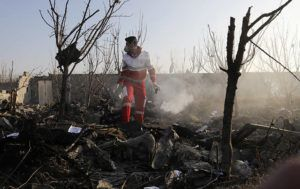 ASSOCIATED PRESS                                 A rescue worker searched the scene where an Ukrainian plane crashed in Shahedshahr, southwest of the capital Tehran, Iran, Wednesday. A Ukrainian airplane carrying 176 people crashed on Wednesday shortly after takeoff from Tehran's main airport, killing all onboard.