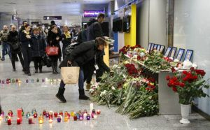 ASSOCIATED PRESS                                 Relative and friends of the flight crew members of the Ukrainian 737-800 plane that crashed on the outskirts of Tehran, lay flowers at a memorial inside Borispil international airport outside Kyiv, Ukraine, Wednesday.