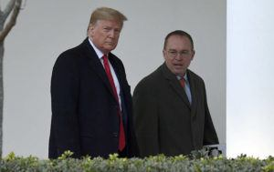 ASSOCIATED PRESS                                 President Donald Trump, left, and acting White House chief of staff Mick Mulvaney, right, walked along the colonnade of the White House, Monday, in Washington. The federal government's watchdog agency says a White House office violated federal law in withholding security assistance to Ukraine aid.