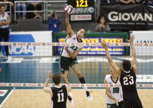 CINDY ELLEN RUSSELL / CRUSSELL@STARADVERTISER.COM                                  Hawaii's Guilherme Voss makes a kill against the Grand Canyon Antelopes during the first set.