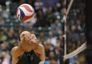 JAMM AQUINO/JAQUINO@STARADVERTISER.COM                                 Hawaii middle blocker Guilherme Voss (12) bumps the ball during the second set of a men's college volleyball game against the Charleston Golden Eagles on Jan. 4 at Stan Sheriff Center in Honolulu. Hawaii won its 20th straight home match tonight, going back to last season.