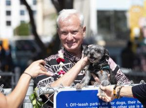 "CINDY ELLEN RUSSELL / CRUSSELL@STARADVERTISER.COM                                 Honolulu Mayor Kirk Caldwell held a dog named ""Pono"" at the opening of a new dog park located in Mother Waldron Park in Kakaako."