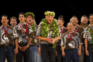 DENNIS ODA / 2015                                 Kumu Hula Robert Cazimero and his kane from Halau Na Kamalei were the overall winner in 2015.