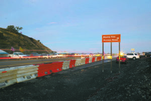 CINDY ELLEN RUSSELL / JULY 18                                 Vehicles pass by near the intersection of Mauna Kea Access Road and Daniel K. Inouye Highway.