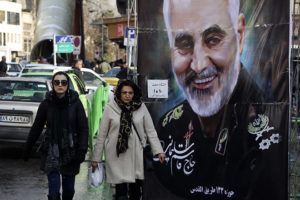 ASSOCIATED PRESS / Jan. 9                                 Women walk past a banner of Iranian Revolutionary Guard Gen. Qassem Soleimani, who was killed in Iraq in a U.S. drone attack, in Tehran, Iran last month.
