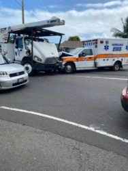 COURTESY KEVIN BRAEKEVELT                                 A city ambulance was responding to an emergency today when it was in a crash with a tree trimming truck in Kailua. One person was taken to a hospital in stable condition. The ambulance workers were not hurt.