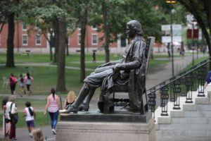 ASSOCIATED PRESS / 2019                                 The statue of John Harvard sits in Harvard Yard at Harvard University in Cambridge, Mass.