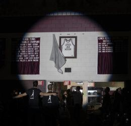 THE PHILADELPHIA INQUIRER VIA AP                                 Kobe Bryant's Lower Merion jersey is unveiled in the Bryant Gymnasium during a ceremony at Lower Merion High School.