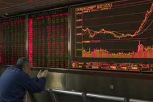 ASSOCIATED PRESS                                 An investor monitors stock prices at a brokerage in Beijing on Jan. 16.