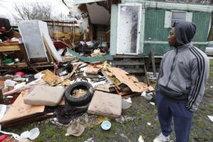 "ASSOCIATED PRESS ""It sounded like it was coming for us,"" says DeMarkus Sly, 19, as he looked at the remains of his grandmother's home in Pickens, Miss., following Wednesday's series of storms that hit Mississippi, today. The home was occupied by five family members including Sly, but none were seriously injured when the home was destroyed by the winds."
