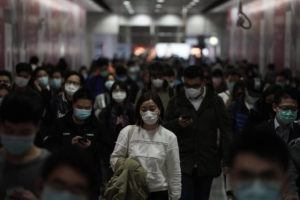ASSOCIATED PRESS / FEB. 7                                 People wearing masks, walk in a subway station, in Hong Kong. Hong Kong on Friday confirmed 25 cases of a new virus that originated in the Chinese province of Hubei. According to the latest figures, 233 new cases of the novel coronavirus have been confirmed globally, Hong Kong's Chief Secretary for Admissions told a news conference.