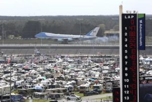 ASSOCIATED PRESS                                 Air Force One touches down at the Daytona Beach International's Airport as seen from Daytona International Speedway as President Donald Trump makes his arrival to attend the NASCAR Daytona 500 auto race today in Daytona Beach, Fla.