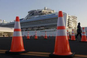 ASSOCIATED PRESS                                 A security guard stood near the quarantined Diamond Princess cruise ship, Feb. 13, in Yokohama, near Tokyo. After 14 days, an extraordinary quarantine of the Diamond Princess cruise ship ends Wednesday, with thousands of passengers and crew set to disembark over the next several days in the port of Yokohama.