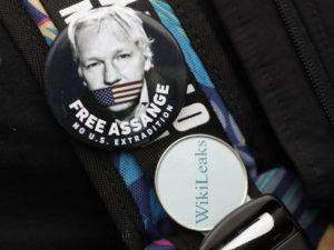 ASSOCIATED PRESS                                 A demonstrator wore badges supporting Julian Assange outside Westminster Magistrates Court in London today.
