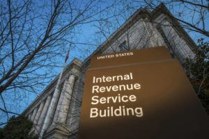 ASSOCIATED PRESS                                 The headquarters of the Internal Revenue Service, seen in April 2014, in Washington. The agency said, today, that it is stepping up its efforts to visit high-income taxpayers who failed in prior years to file their tax returns on time.
