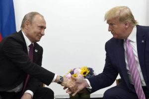 ASSOCIATED PRESS                                 President Donald Trump, right, shook hands with Russian President Vladimir Putin, left, during a bilateral meeting, June 28, on the sidelines of the G-20 summit in Osaka, Japan. Intelligence officials have warned lawmakers that Russia is interfering in the 2020 election campaign to help President Donald Trump get reelected, according to three officials familiar with the closed-door briefing.