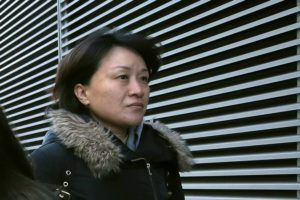 ASSOCIATED PRESS                                 Xiaoning Sui, a Chinese national residing in British Columbia, Canada, left federal court, today, in Boston, after pleading guilty to paying $400,000 to get her son into the University of California, Los Angeles, as a fake soccer recruit.
