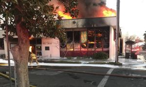 THE PORTERVILLE RECORDER VIA AP                                 Flames engulf the public library on Tuesday in Porterville, Calif.